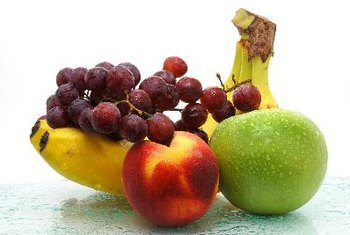 Keeping snacks such as fresh fruit nearby can help prevent low blood sugar while traveling.