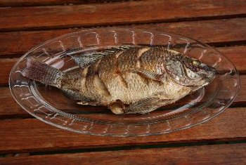 Tilapia can be grilled whole as a low-fat cooking method that adds extra flavor to the fish.