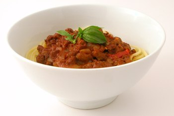 Make spaghetti Bolognese healthier by using whole-wheat spaghetti and lean ground beef.