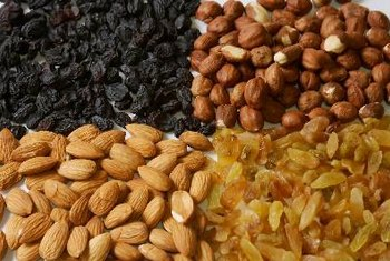 Nuts and raisins offer plenty of nutrition -- with high calorie counts.