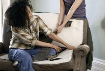 An extra set of hands can make upholstery removal an easier task.