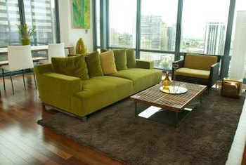 Use an area rug to define and anchor the furniture arrangement in a small living room.