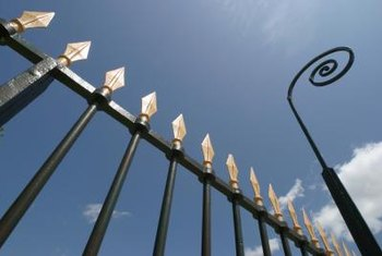 Metal fences add a decorative touch to your yard.