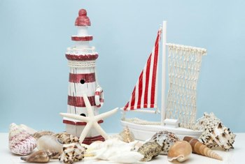 Shells and a painted red-and-white striped lighthouse make a fun centerpiece.
