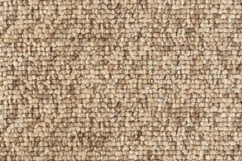 Textured carpet fibers are steam treated to make them twist.