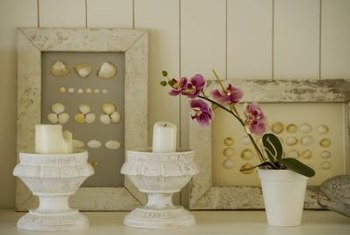 Candles and framed art decorate mantel shelves.