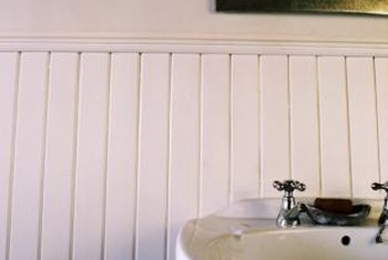 What Type of Paint Do I Use on Bathroom Wainscoting? Semi-gloss and gloss paints are easier to clean than flat ones.