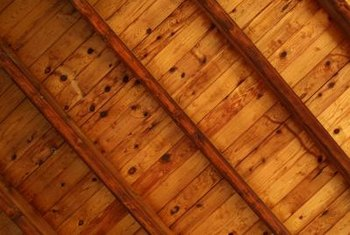 A wood ceiling has a cozy, inviting look that works well in a living room or family room.