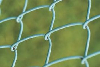 With green coating, chain link fencing can disappear into your yard, making a small area look more open.