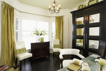 Taffeta drapes can work with contemporary furniture as long as the room feels balanced.