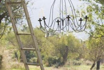An outdoor candle chandelier is flickering fun on a summer evening.