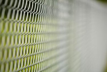 PVT inserts turn a chain-link fence into a privacy fence.