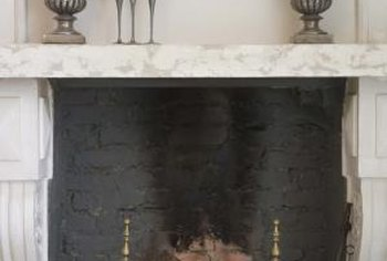 A pair of topiary ivy create a stately effect on a fireplace mantel.