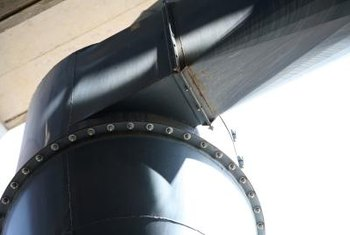 A square-to-round fitting connects a round duct to a dust collector.