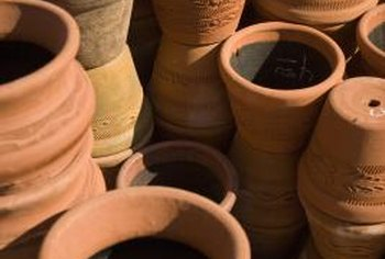 Turn your hoard of unused clay pots into a tiered planter for colorful flowers.