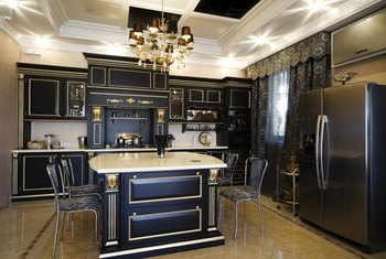 Semi-concealed gold hinges enhance this kitchen with its traditional black cabinetry.