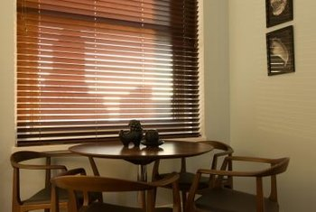 Faux wood blinds look like genuine wood from a distance.