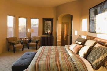 A bay window makes an ideal spot for a bedroom sitting area.