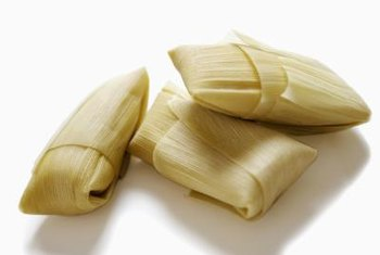 Serve chicken tamales without sauce for less sugar per serving.
