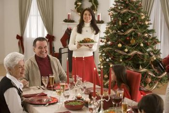 Dress dining chairs in their finest red slipcovers to complement ornaments.
