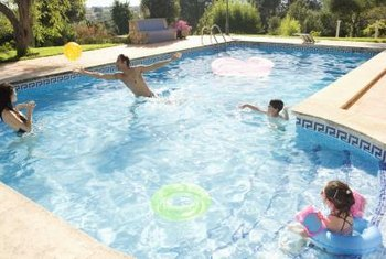 Calcium deposits won't necessarily harm swimmers, but they can permanently damage the pool.