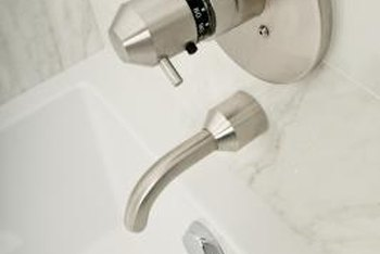 A tub trip lever fits into the overflow hole below the spout.