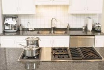 Refinishing gives kitchen cabinets a new look at a reasonable cost.