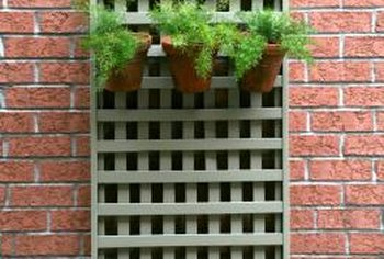 Lattice boards applied over an ugly brick wall and make it more attractive.