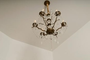 Lower the chandelier so you can safely clean it.