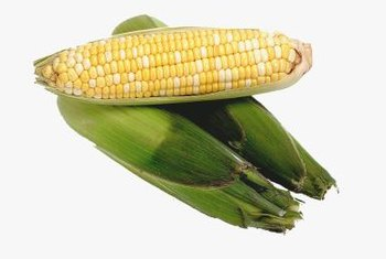 Corn is a food that contains carbohydrates, including starches.