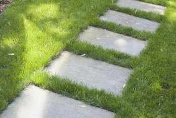Fill in a concrete stepping stone path with pea gravel to reduce maintenance.