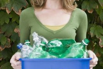 Plastic bottles can be recycled into plant self-watering systems.