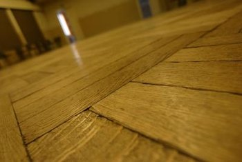 Mildew can appear as streaks or blotches on hardwood.