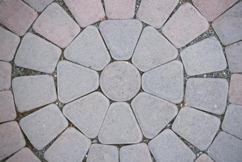 Filling in the gaps between pavers helps prevent them from shifting.
