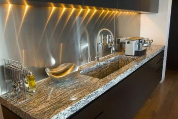 Granite and stainless steel evoke a senseof sustainability and efficiency in contemporary kitchens.