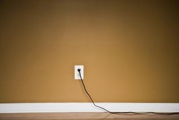 The first rule of camouflaging wires is to make them the same color as the background.