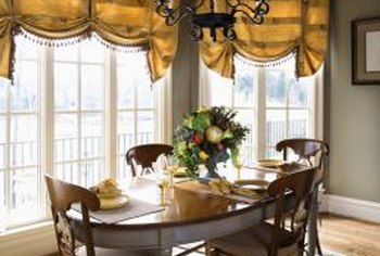 A chandelier should match the scale of table and room.
