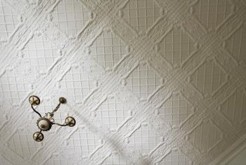 Paint textured ceilings quickly with a sprayer.