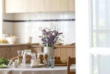 A casual flower arrangement completes a bright, airy kitchen.