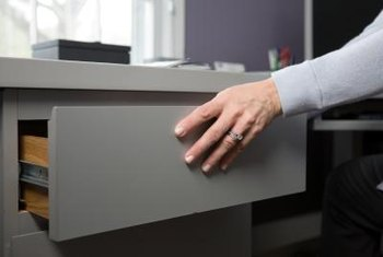 Tightening the glides helps restore the smooth operation of your drawer.