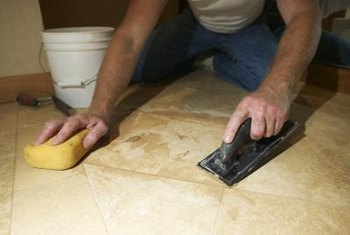 Grout the base and floor tiles using a sponge trowel.