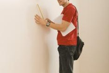 Smooth your wall by coating it with joint compound.