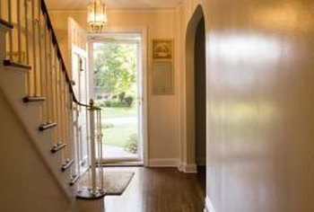 In a colonial home, light earth tones like cream or sand work best for hallway walls.