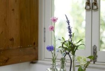 Old jars make lovely vases for your fresh garden blooms.