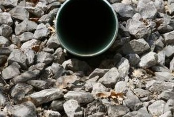 Use a perforated PVC pipe, if desired, to spread drainage over a larger area.