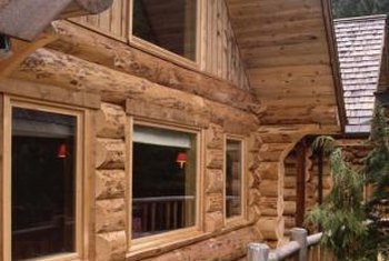 New siding, windows and a wrap-around deck give a fresh look to an old cabin.