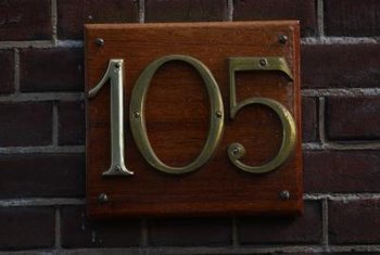 Metal numbers affixed to a wooden plaque is a classic, upgraded way to display your home address.