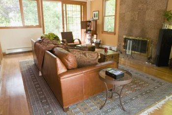 Orange-yellow or tan walls blend with flooring while linking with orange-brown furniture.
