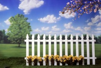 A picket fence provides a temporary backdrop for flowers.