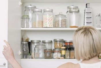 Glass jars work well as food storage in an armoire-turned-pantry.
